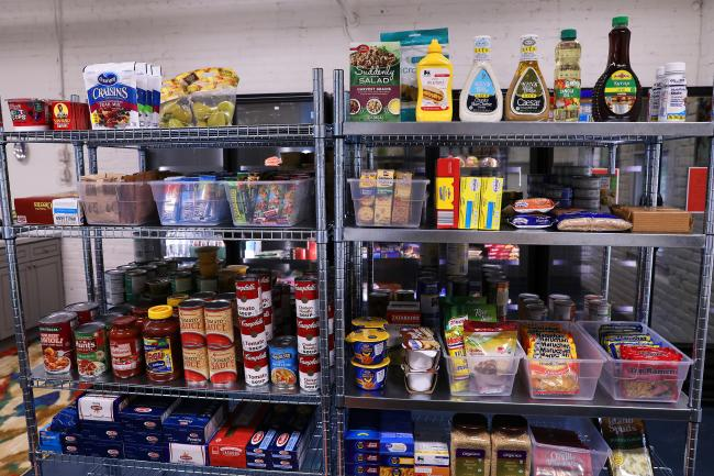 Shelves of food that can be shopped for at Lula Bell's