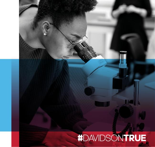 DAVIDSONTRUE student looking through a microscope