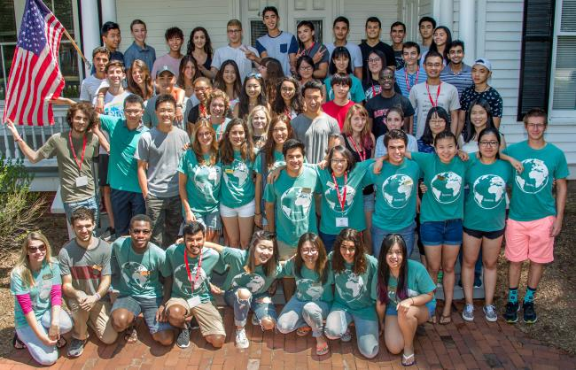 International Students at Orientation Pose on House Steps