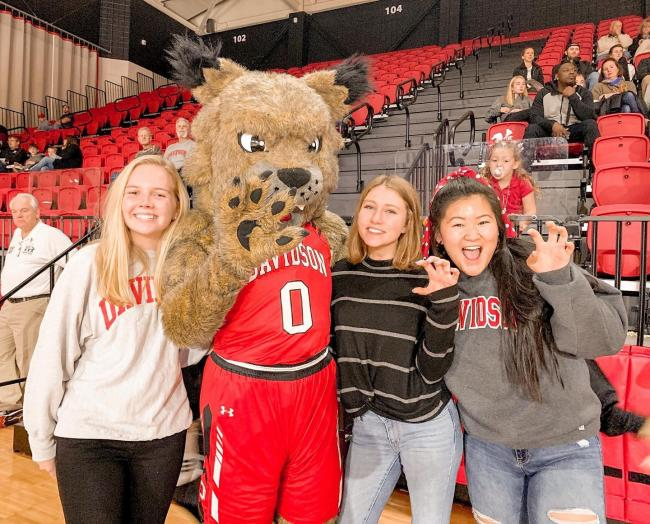 spirited Davidson students pose with mascot