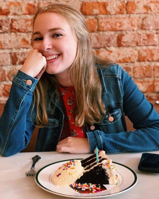 young woman having a slice of cake