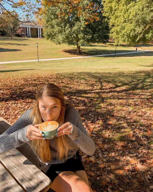 student enjoys a cup of coffee at Summit