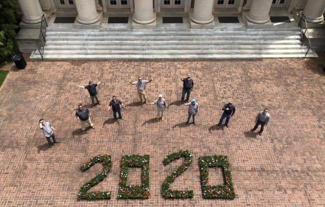 2020 spelled out in plants and various flowers