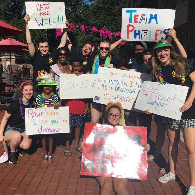 orientation team with signs and fun costumes