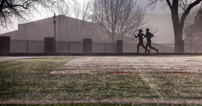 Runners make their way around the Irwin Belk Track on a brisk January morning.