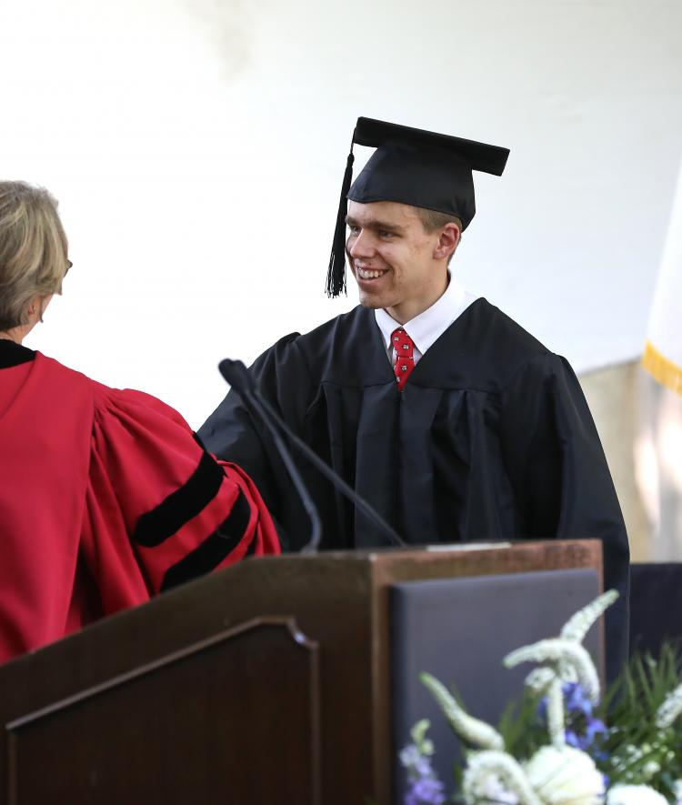 Henry Brooks receives diploma
