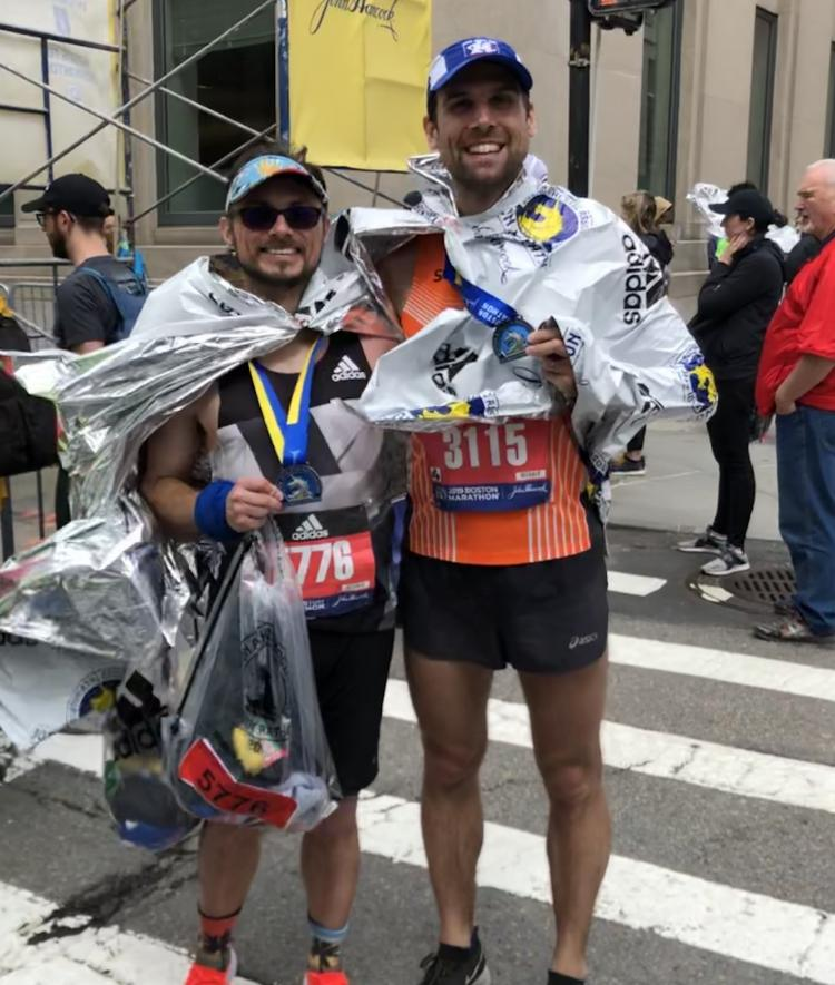 Physics professor and friend pose with medals at end of Boston Marathon