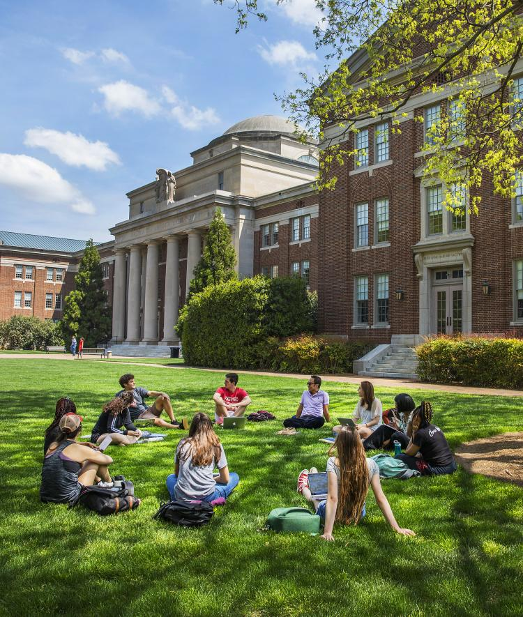 Class in front of Chambers with Students sitting on the grass