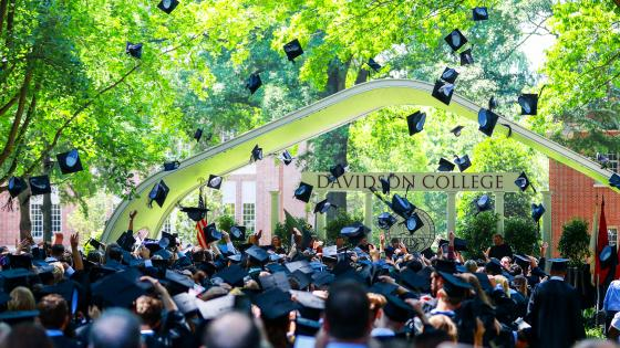Commencement Graduates throw Hats in the Air