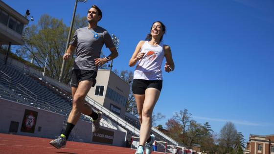 Two physics professors run on the track