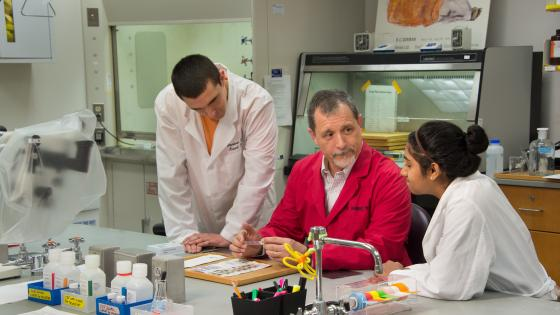 Julio Ramirez in Lab with Students