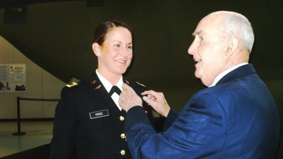 Alumnus Retired Air Force Brigadier General John Rose pins aviator wings on granddaughter Emily King