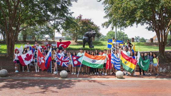 International Students with Flags from Various Countries by Bronze Wildcat