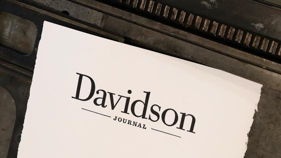 "Paper with the ""Davidson Journal"" wordmark printed on it atop a letterpress"