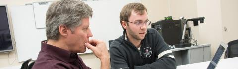 JD Mills and Prof. Mahoney consult on technology ideas
