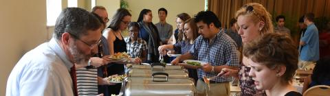 Students and staff at luncheon make plates from catered food