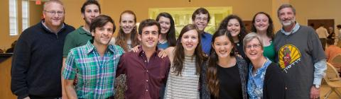 Jewish students and chaplains smile at the camera