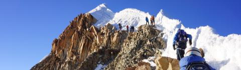 People climb mountain in Bolivia that is covered in ice