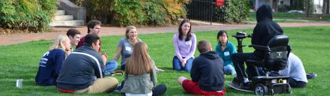 Chidsey Fellows gather in a circle on Chambers lawn