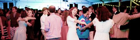 Fall Fling students and alumni dance in outdoor tent