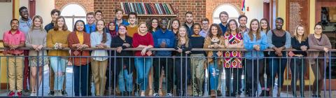 Belk Scholars pose on a balcony