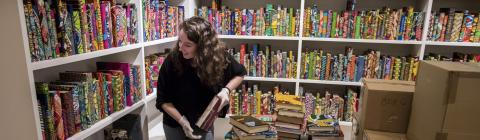 Student Helps Shelve Books in Yinka Shonibare's American Library Exhibit