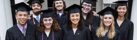 Graduating Belk Scholars in caps and gown pose in group