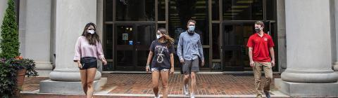 Students in Masks in Front of Library