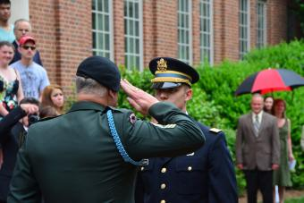 Military official salutes ROTC student outside