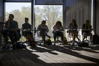 Wall Center Students sitting at desks in class with window behind