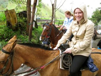 Two students ride horses in Colombia in an annual political science trip