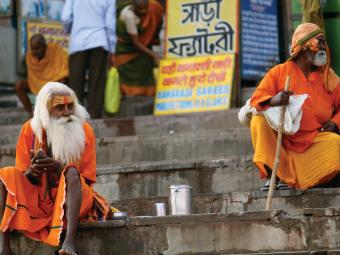 Hindu sannyasins rest from their travels. Sheetla Ghat, or steps, is home to the sunset aarti, an evening prayer ritual offered to the holy river Ganges.