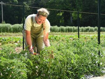 Theresa tends to plants at the Farm at Davidson