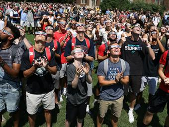 Students on the front lawn during the eclipse