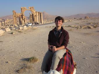 Student Studying Abroad on a Camel