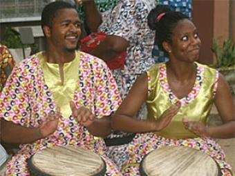 V.J. Brown '15 and Christi Moore '15 playing the drums in Ghana