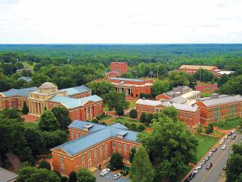 Aerial of Davidson College campus showing lots of campus buildings and trees
