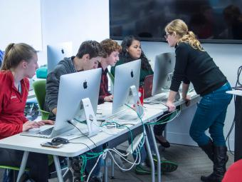 Students and professor use public computing facility during class