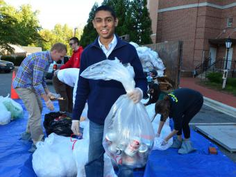 Student holds bag of recycling