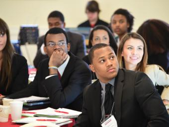 Students listen to a presentation during a career event