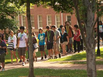 Group of young students on campus for camp walk together