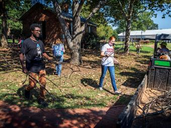 Campus cleanup where student help college landscaping after a hurricane