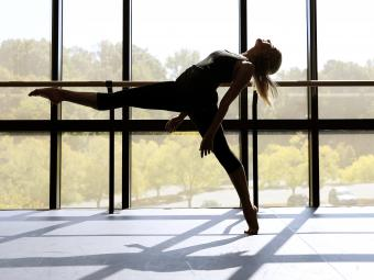 Dance Program student in front of large window