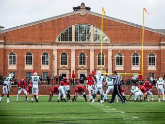 Football Game at Richardson Stadium with players and ref on the field