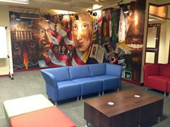 Room with a mural, couches and coffee table
