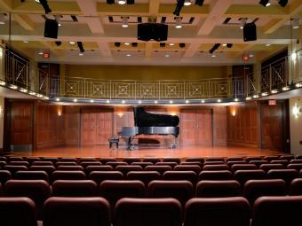 Tyler-Tallman auditorium with piano on stage and open seating