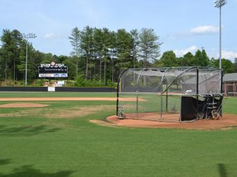 Wilson field showing the score board and batting practice equipment