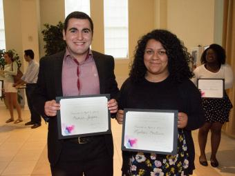Students hold awards from Celebration of Service