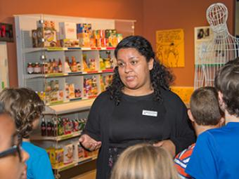Marlene Arellano '17 teaches students in the Levine Museum's History ACTIVE summer program.