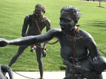 Monument of chained persons trying to free themselves